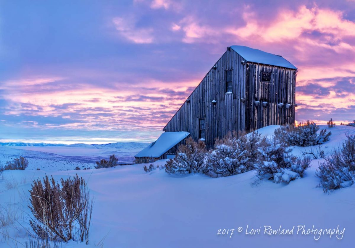 A winter sunrise photo of the Mine Building at the Oregon Trail Interpretive Center in Baker City, Oregon by Lori Rowland Photography