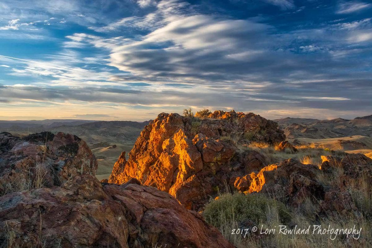 Fading sunlight warms the red rock formations common in the Leslie Gulch region located in remote Eastern Oregon.